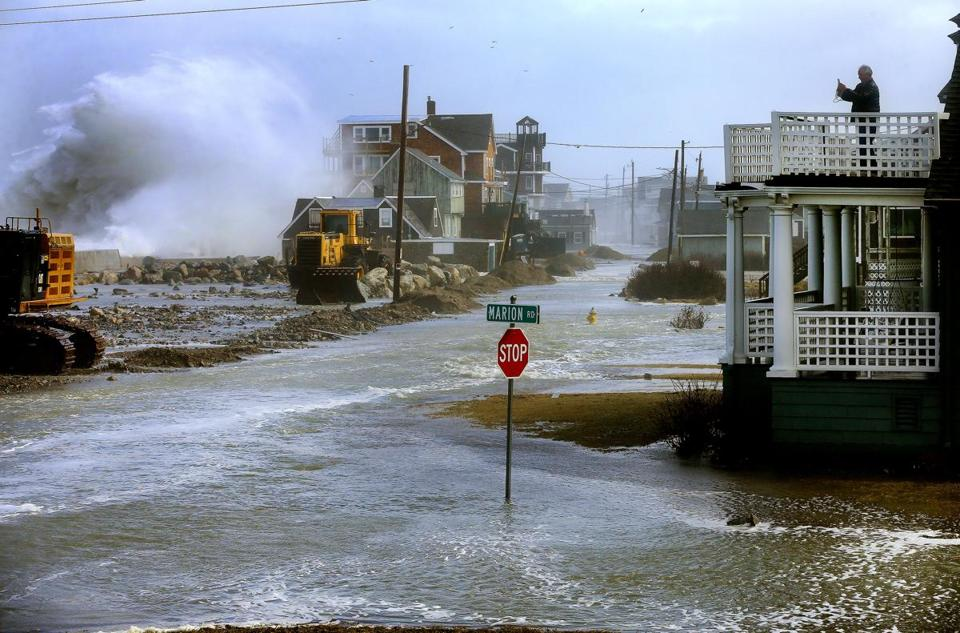 Coastal residents wait for flooding and winds to subside ...